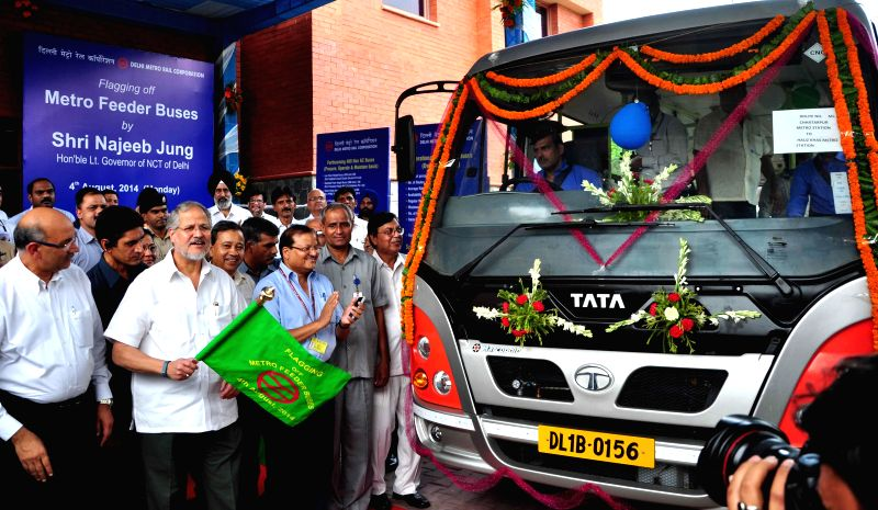 Delhi Lt Governor Najeeb Jung flags-off a new fleet of Metro Feeder buses in New Delhi on Aug 4, 2014.