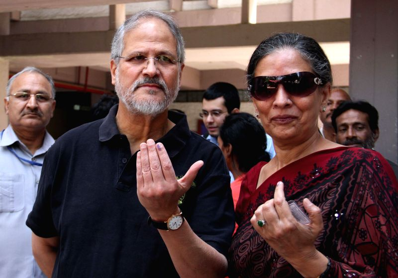 Delhi Lt Governor Najeeb Jung shows his fore finger marked with phosphoric ink after casting his vote during the third phase of 2014 Lok Sabha Polls in New Delhi on April 10, 2014. Elections are ...