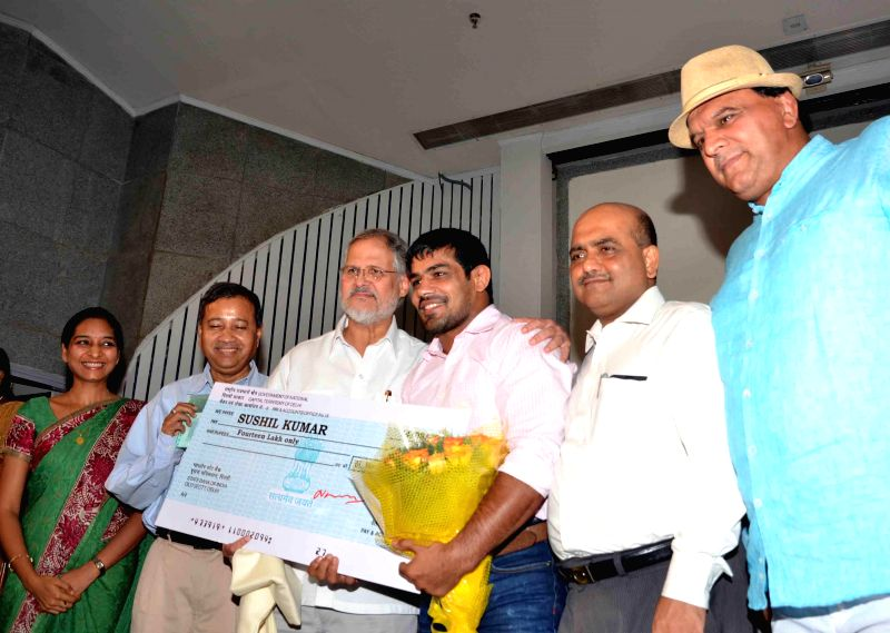 Delhi Lt Governor Najeeb Jung with wrestler Sushil Kumar during a felicitation programme organised at Delhi Secretariat in New Delhi on Aug 22, 2014. - Sushil Kumar