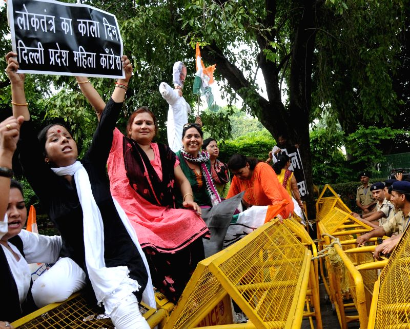 Delhi Mahila Congress workers stage a demonstration against the suspension of Congress MPs  in New Delhi, on Aug 4, 2015.