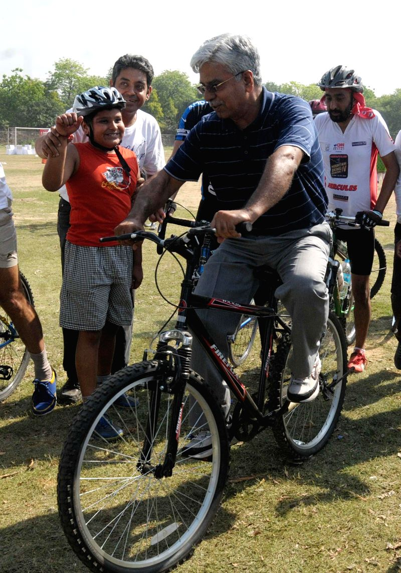 Delhi Police Commissioner B.S. Bassi during flagging-off ceremony of a Cyclothon for road safety in New Delhi on April 20, 2014.