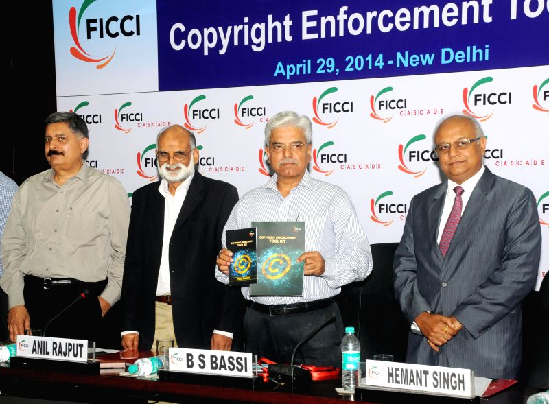 Delhi Police Commissioner BS Bassi releases Copyright Enforcement Tool Kit during a round table meeting organised by FICCI in New Delhi on April 29, 2014.