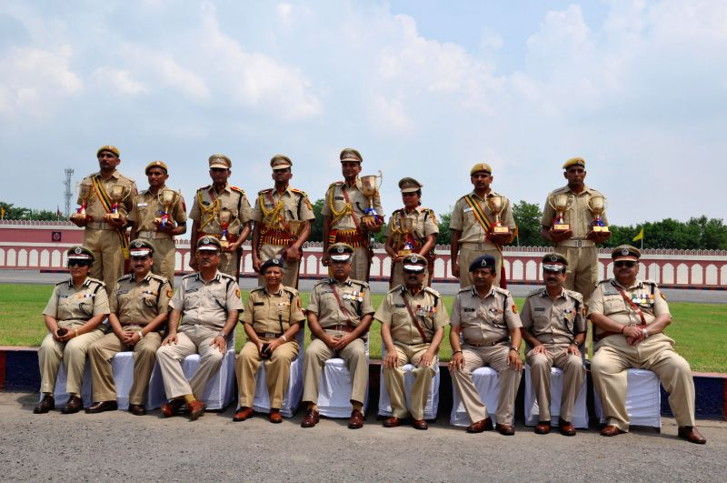 Delhi Police Commissioner BS Bassi with 12th batch of DANIPS (Prob.)/PONDIPS during its Passing out Parade at Police Training College, Jharoda Kalan, New Delhi on August 1, 2014.