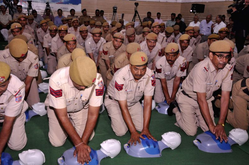 Delhi Police Control Room (PCR) van staff during a training camp on life saving technique of Hands Only Cardio Pulmonary Resuscitation (CPR) for Delhi Police Control Room (PCR) van staff ...