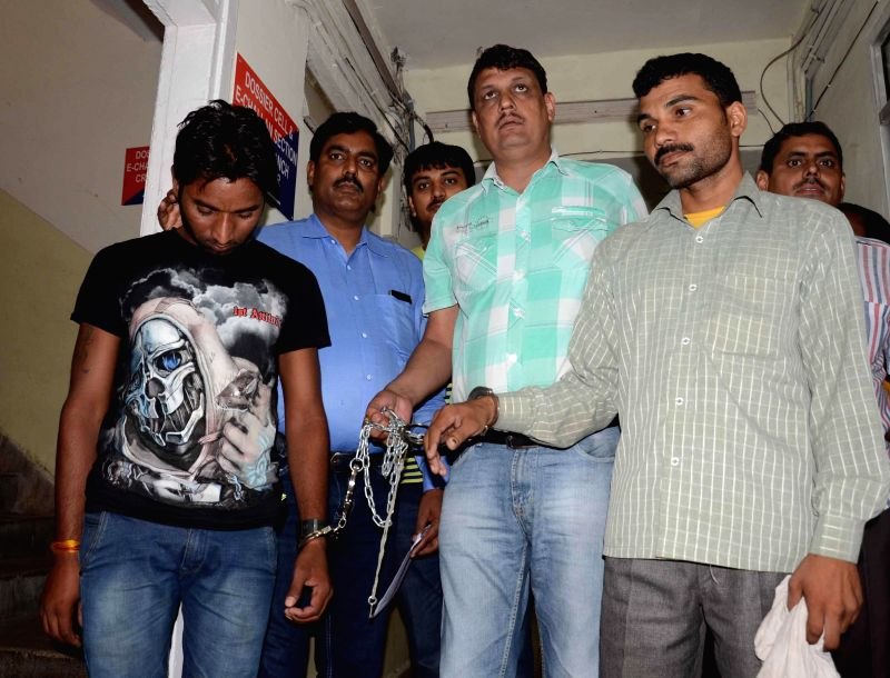Delhi Police Crime branch presents two persons who were allegedly involved in arms racket, before media at Kotwali police station in New Delhi on May 13, 2014.