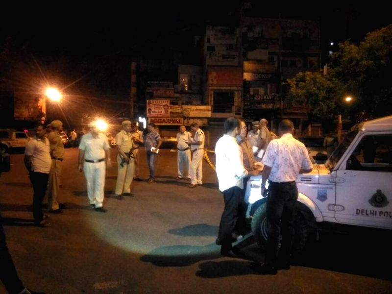 Delhi Police team carries out investigation at the spot where three persons, including an Assistant Sub-Inspector of Delhi Police were shot dead and a constable was injured, in an apparent ...