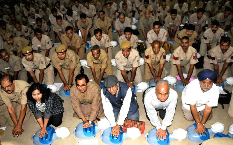 Delhi policemen during a Cardiopulmonary resuscitation (CPR) training session in New Delhi  on July 13, 2015. Also seen General Secretary of Indian Medical Association, Delhi,  Dr. K K ... - Anita Roy