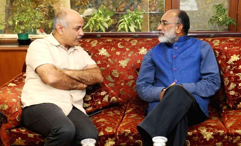 Delhi's Deputy Chief Minister Manish Sisodia calls on Union Tourism Minister Alphons Kannanthanam in New Delhi on Oct 12, 2017. - Manish Sisodia