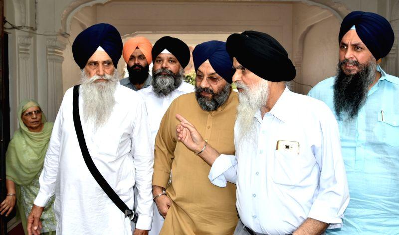 Delhi Sikh Gurdwara Management Committee (DSGMC) president Manjit Singh GK.along other members meeting with Akal Takht Jathedar Gaini Gurbachan Singh at Akal Takht Sahib, Amritsar on May 6, ... - Manjit Singh G