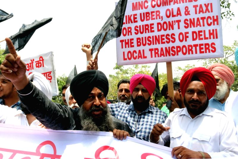 Delhi taxi operators stage a demonstration against multi national taxi operators in New Delhi, on May 23, 2016.