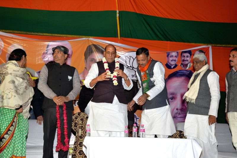 Union Home Minister Rajnath Singh with other leaders addressing an election rally at Musthafabad, Delhi on Feb. 3, 2015. ( Photo : IANS )