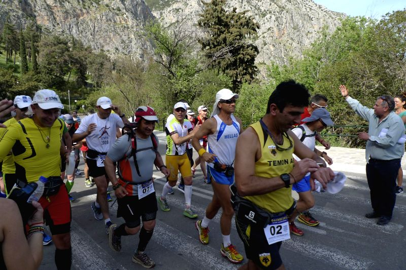 Twenty five ultra-marathoners from Greece and other countries compete during a 255-kilometer non stop race from Delphi at central Greece to the birthplace of the ...