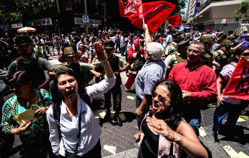 "Demonstrators shout slogans during the march ""No more AFP"" in Santiago, capital of Chile, on Dec. 10, 2015. According to the organizers, the march is held to protest against the ..."