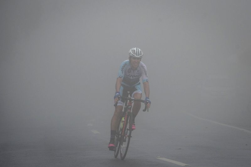 DENPASAR, Jan. 28, 2018 - A cyclist competes in the foggy weather in Bedugul, Bali province during stage 4 of the Tour de Indonesia 2018, on Jan. 28, 2018.