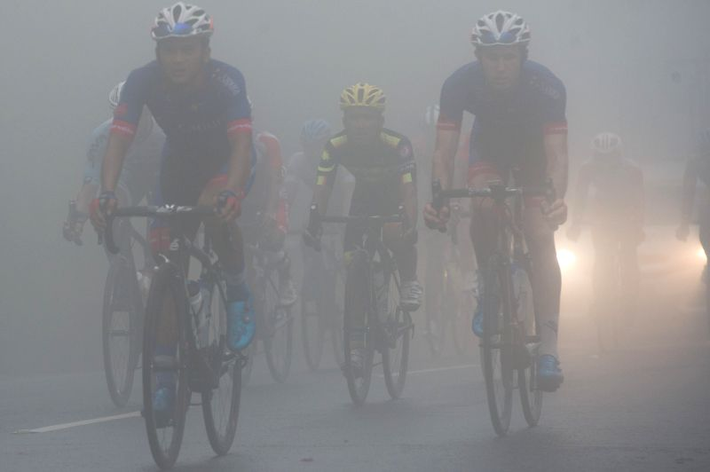DENPASAR, Jan. 28, 2018 - Cyclists compete in the foggy weather in Bedugul, Bali province during stage 4 of the Tour de Indonesia 2018, on Jan. 28, 2018.