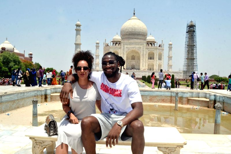 Denver Nuggets forward/center Kenneth Faried with his girlfriend visit the Taj Mahal in Agra on May 18, 2017.
