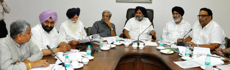 Deputy Chief Minister Punjab Sukhbir Singh Badal presiding over a high level meeting on governance reforms in Chandigarh on June 16, 2014. - Punjab Sukhbir Singh Badal