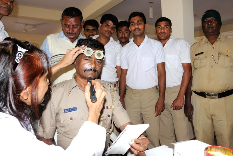 Deputy Commissioner of Police CM Kantarajappa at a free eye and health check up camp for Audgodi Police personnel organised at Audugodi Police quarters in Bangalore on July 15, 2014.