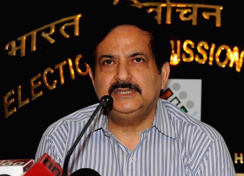 Deputy Election Commissioner Vinod Zutshi addresses a press conference at Nirvachan Sadan in New Delhi on May 6, 2014.