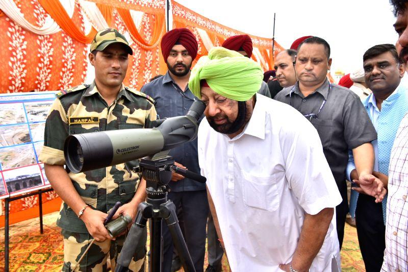 Dera Baba Nanak: Punjab Chief Minister Amarinder Singh have 'darshan' of Gurdwara Kartarpur Sahib, located across the border, with the help of binoculars during his visit to Punjab's Dera Baba Nanak to take stock of the ongoing construction work for