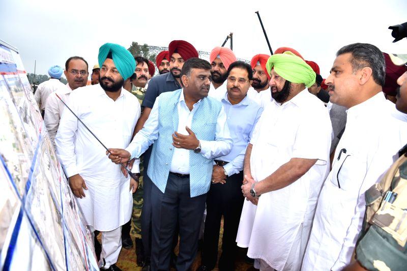 Dera Baba Nanak: Punjab Chief Minister Amarinder Singh takes stock of the ongoing construction work for the Kartarpur corridor ahead of the 550th Prakash Purb of Guru Nanak Dev, in Punjab's Dera Baba Nanak on Sep 19, 2019. (Photo: IANS)