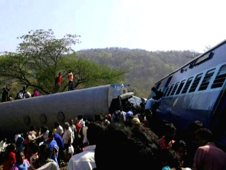 Derailed bogies of Diva-Sawantwadi express near Nagothana in Raigarh of Maharashtra on May 4, 2014. The engine and four coaches of the train were derailed. Three people are feared dead.