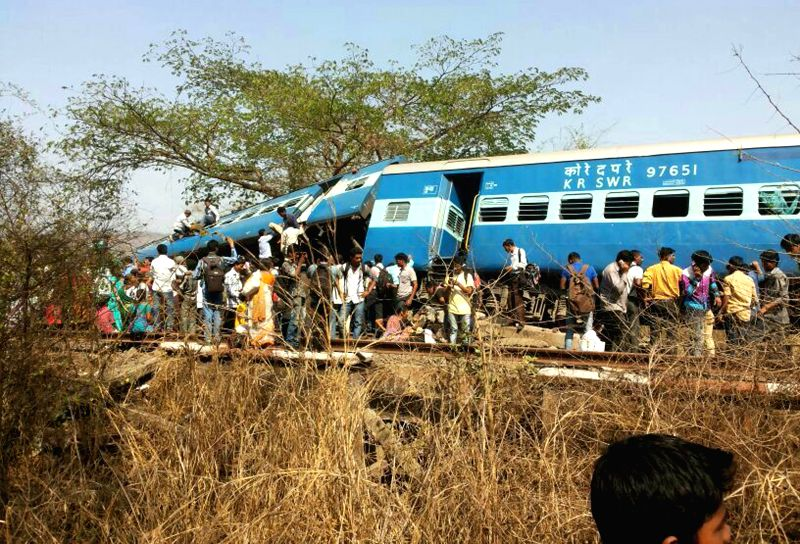 Derailed bogies of Diva-Sawantwadi express near Nagothana in Raigarh of Maharashtra on May 4, 2014. The engine and four coaches of the train were derailed. Three people are feared dead. Nine people ..