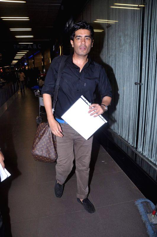 Designer Manish Malhotra leave for London at International Airport. - Manish Malhotra
