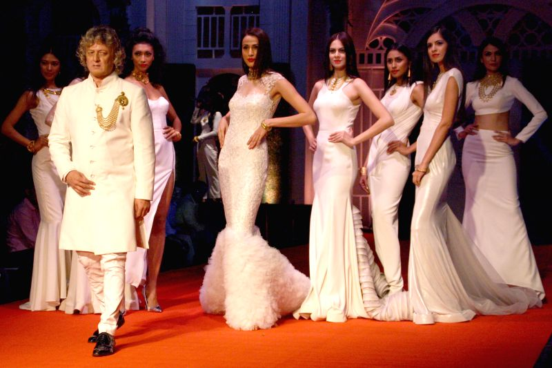 Designer Rohit Bal showcasing AZVA creations during `BMW India Bridal Fashion Week 2014`, in New Delhi on August 09, 2014. - Rohit Bal