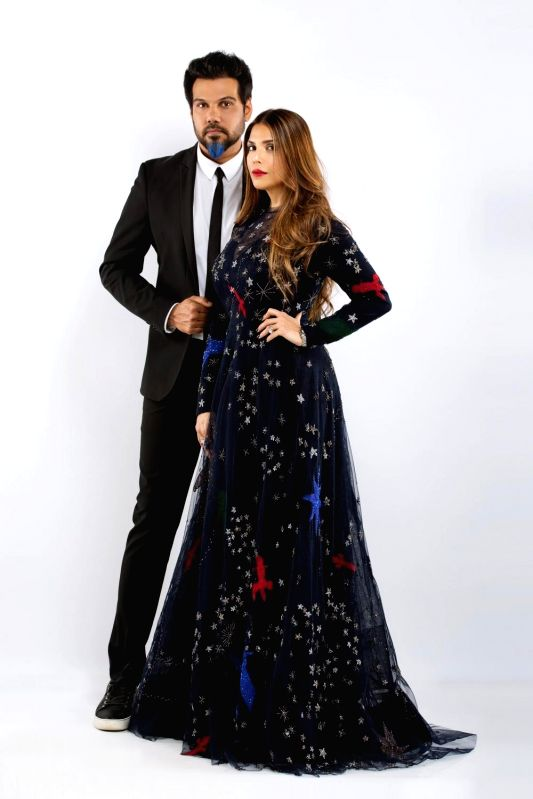 Designers Shane and Falguni Peacock with couture collection Amour De Junagarh.