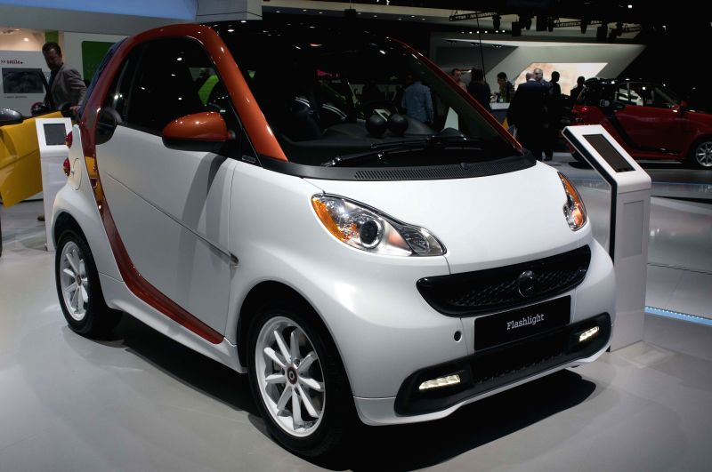 A Smart fortwo car is exhibited during the 2015 North American International Auto Show (NAIAS) in Detroit, the United States, Jan. 12, 2015. (Xinhua/He ...