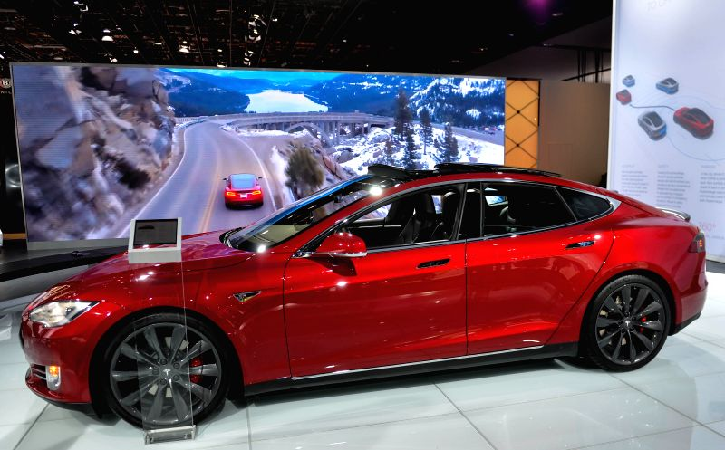Tesla Motors' Model S is displayed during a press preview of the 2015 North American International Auto Show(NAIAS) in Detroit, the United States, Jan.13, 2015. ...