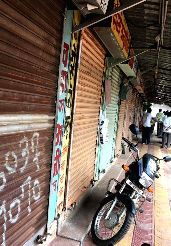 Deulgaon Raja: Shops remain closed as Maratha community call for a state-wide shutdown demanding reservation for the community, at Deulgaon Raja in Buldhana district of Maharashtra on July 24, 2018.