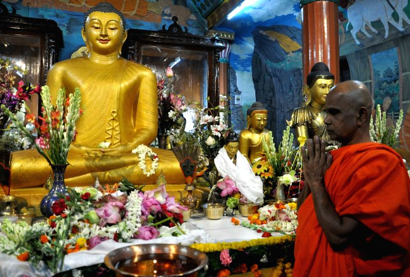 Devotee offers prayers at a Buddhist temple on Buddha Purnima day in Kolkata on May 21, 2016.