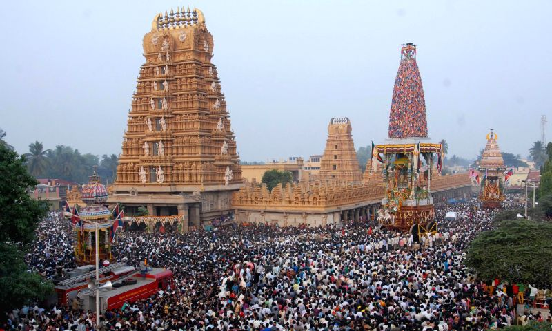 Devotees across the state swarmed the temple town of Nanjangud to witness the Panchamaha Rathotsava in Mysore on April 11, 2014. (Photo : IANS)