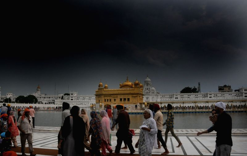 Devotees at Golden Temple on an overcast day, in Amritsar on July 25, 2018.