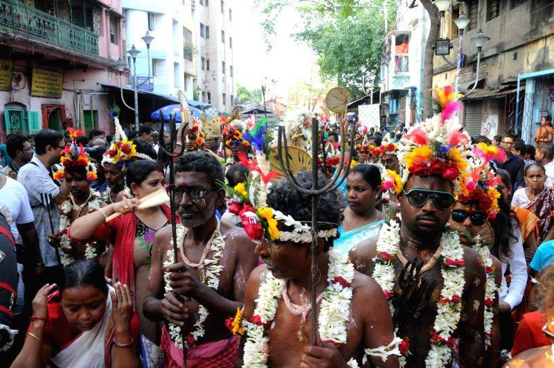 Devotees celebrate Ganjan Festival in Kolkata, on April 13, 2018.