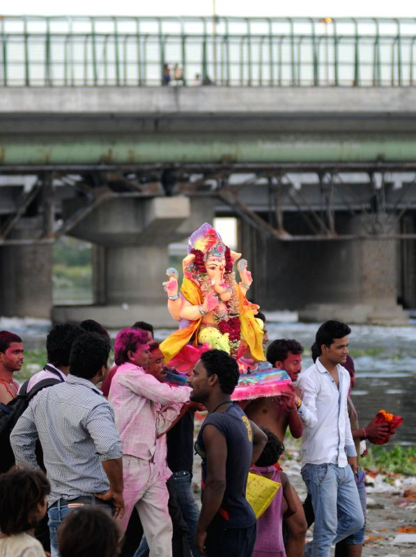 Devotees during Ganesh idol immersions on the banks of Yamuna river near ITO in New Delhi on Sept. 1, 2014.