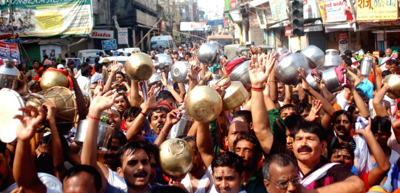Devotees en-route to Kashi-Viswanath Temple on the first Monday of Sawan - Holy month of Hindu calendar in Varanasi on July 14, 2014.