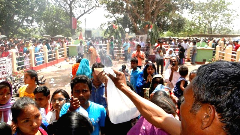 Devotees gather at Babedpara in West Garo Hills about 50 km from Tura to celebrate the annual Charantala Kali Puja on April 22, 2014.