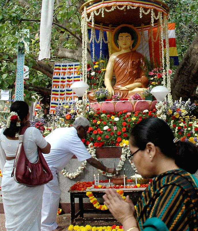 Devotees gather at Mahabodi Society on 2558th birth anniversary of Lord Buddha in Bangalore on May 14, 2014. Buddha Purnima is the most sacred day in the Buddhist calendar and celebrated on the ...