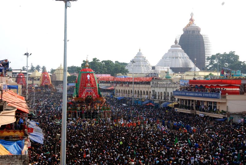 Devotees in large numbers participate in `rath yatra` (chariot procession) in Puri on June 29, 2014. (Photo : IANS)