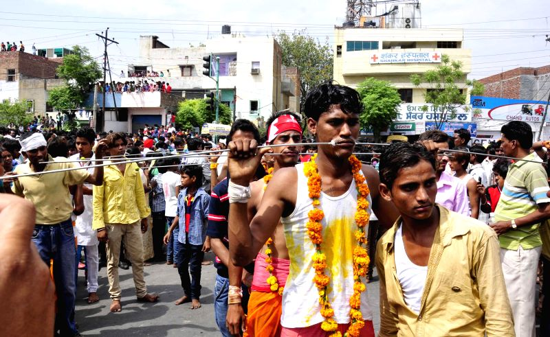 Devotees of Mahamariamman participate in a religious procession in Amritsar on May 11, 2014.