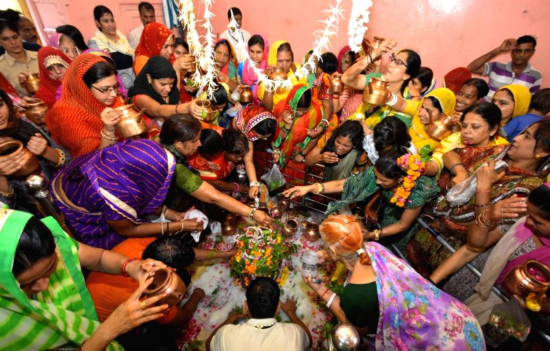 Devotees offer milk and water to Lord Shiva on the first monday of Shravan month at Jharkhand Temple in Jaipur on July 25, 2016.