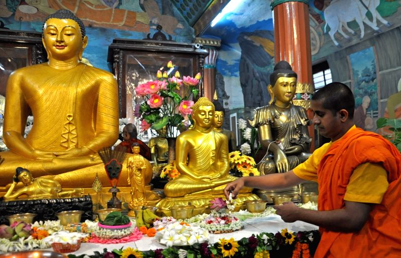 Devotees prayers to Lord Buddha on the eve of Buddha Purnima