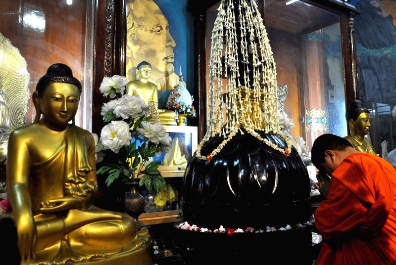 Devotees offer prayers to Lord Buddha on the eve of Buddha Purnima, at a Buddhist temple in Kolkata