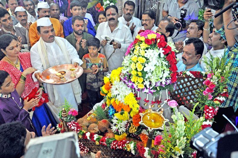 Devotees offers prayers to Lalbaugcha Raja on Angarki Sankashti Chaturthi in Mumbai, on June 13, 2017.