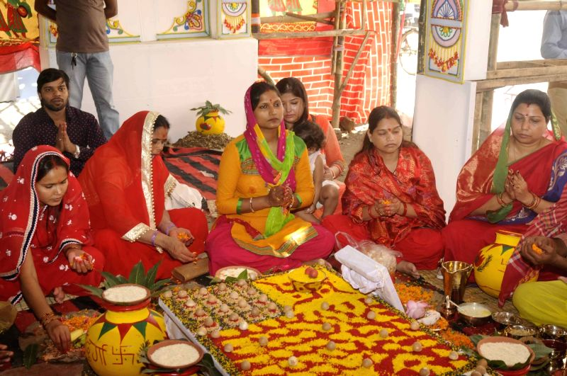 Devotees participate during a Kalasha Sthapana (holy water vessel) ritual on the first day of Navaratri festival in Patna.