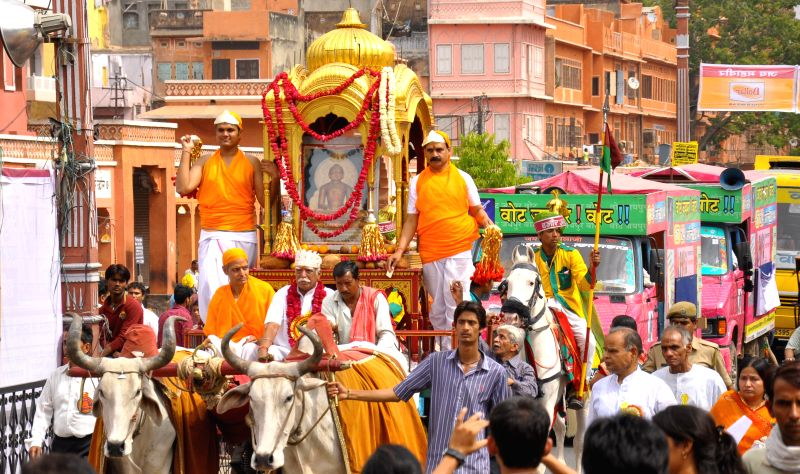 Devotees participate in a procession organised on Mahavir Jayanti in Jaipur on April 13, 2014.