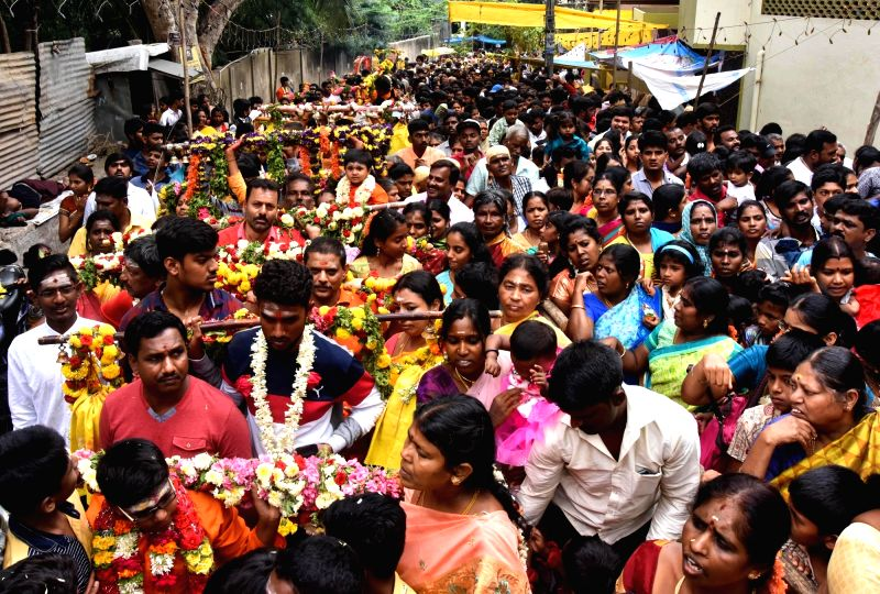 Devotees participate in a procession organised on Adi Krithika Mahotsava at Subramanya Swamy Temple in Bengaluru, on Aug 5, 2018.